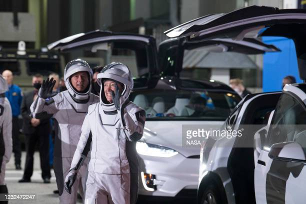 In this handout image provided by NASA, NASA astronauts Shane Kimbrough and Megan McArthur wave as they prepare to depart the Neil A. Armstrong...