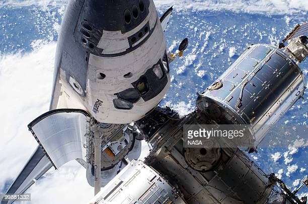In this handout image provided by NASA, space shuttle Atlantis's cabin and forward cargo bay and part of the International Space Station while the...