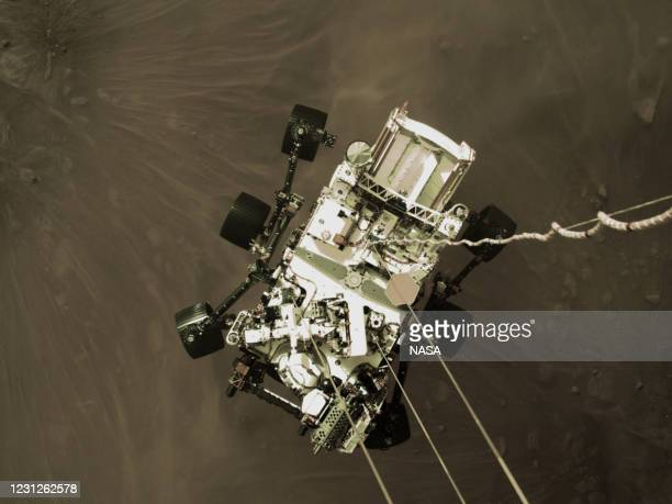 In this handout image provided by NASA, still image is part of a video taken by several cameras aboard the descent stage as NASA's Perseverance rover...