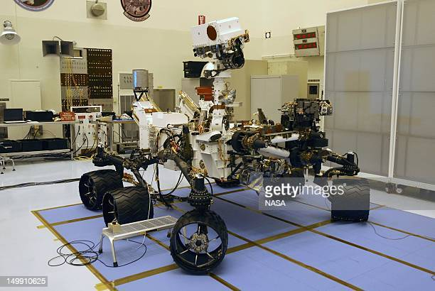 In this handout image provided by NASA technicians work on the Mars Science Laboratory rover Curiosity in the Payload Hazardous Servicing Facility at...