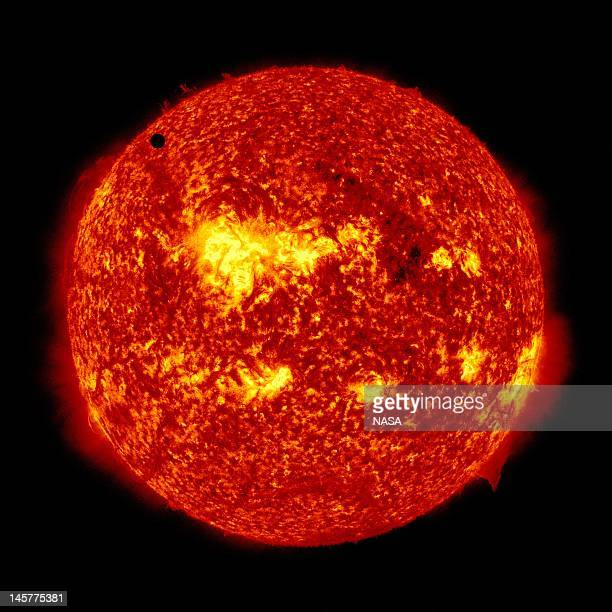 In this handout image provided by NASA the SDO satellite captures a ultrahigh definition image of the Transit of Venus across the face of the sun at...
