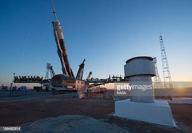 In this handout image provided by NASA the Soyuz rocket is erected into position after being rolled out to the launch pad by train at the Baikonur...