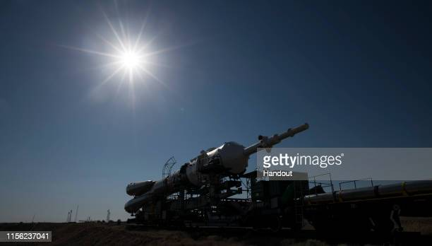 In this handout image provided by NASA The Soyuz rocket is seen as it approaches the launch pad by train at Baikonur Cosmodrome on July 18 2019 in...