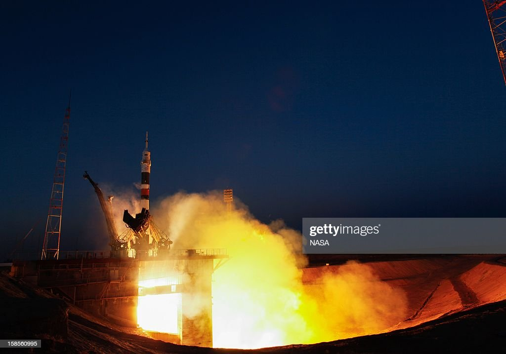 In this handout image provided by NASA, The Soyuz TMA-07M launches at the Baikonur Cosmodrome on December 19, 2012 on Baikonur, Kazakhstan. The Launch of the Soyuz rocket took place at 06:12 local time and is sending Expedition 34/35 Flight Engineer Tom Marshburn of NASA, Soyuz Commander Roman Romanenko and Expedition 35 Commander Chris Hadfield of the Canadian Space Agency (CSA) on a five-month mission aboard the International Space Station.