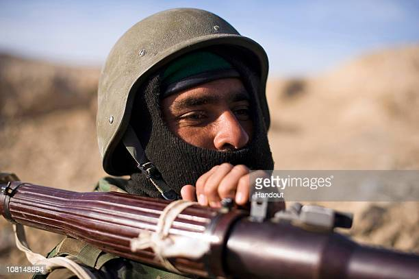 In this handout image provided by NATO Training Mission Afghanistan an Afghan National Army soldier holds on tightly to a Rocket Propelled Grenade...