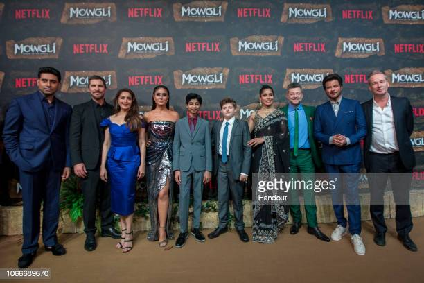 In this handout image provided by NETFLIX Abhishek Bachchan Christian Bale Madhuri Dixit Kareena Kapoor Rohan Chand Louis Ashbourne Serkis Freida...