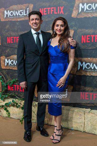 In this handout image provided by NETFLIX Sriram Nene and Madhuri Dixit attend the Mowgli World Premiere on November 25 2018 in Mumbai India