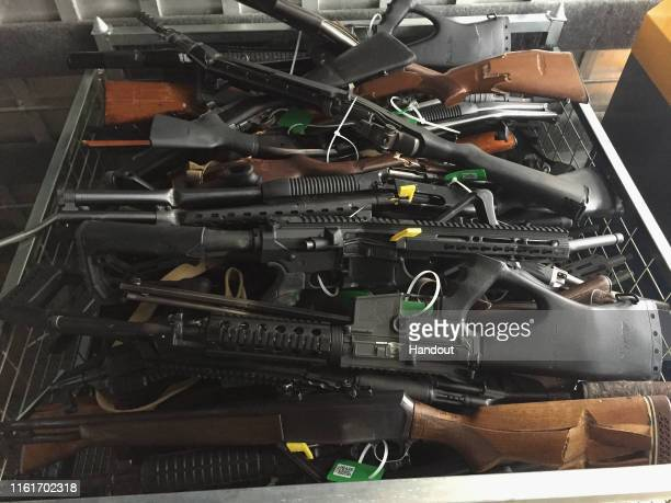 In this handout image provided by New Zealand Police, collected firearms are seen at Riccarton Racecourse on July 13, 2019 in Christchurch, New...