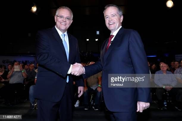 In this handout image provided by News Corp Australia Prime Minister Scott Morrison and the Opposition Leader Bill Shorten shake hands before the Sky...