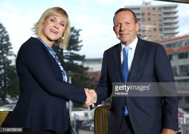 In this handout image provided by News Corp Australia, Warringah candidates Tony Abbott and Zali Steggall shake hands at the beginning of the Sky...