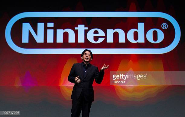In this handout image provided by Nintendo of America, Satoru Iwata, president of Nintendo Co. Ltd., gives the keynote address at the Game Developers...