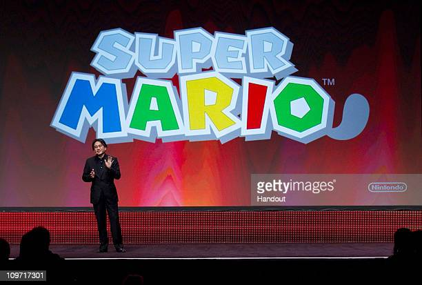 In this handout image provided by Nintendo of America Satoru Iwata president of Nintendo Co Ltd gives the keynote address at the Game Developers...