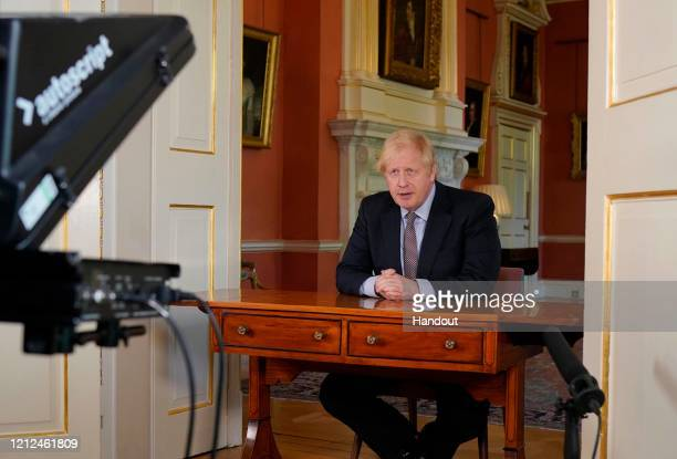 LONDON ENGLAND In this handout image provided by No 10 Downing Street Britain's Prime Minister Boris Johnson records a televised message to the...