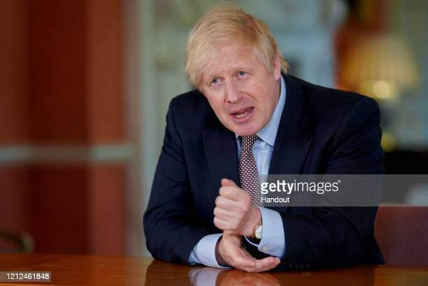 In this handout image provided by No 10 Downing Street, Britain's Prime Minister Boris Johnson records a televised message to the nation released on...