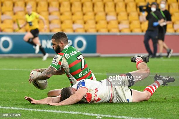 In this handout image provided by NRL Photos Adam Reynolds of the Rabbitohs scores a try during the round 20 NRL match between the St George...