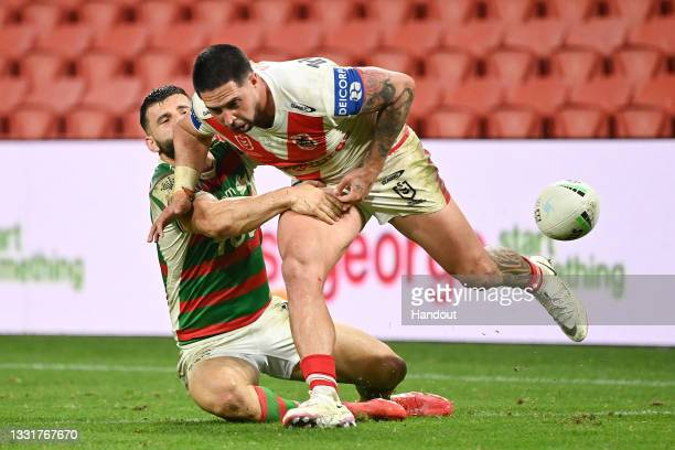 In this handout image provided by NRL Photos Gerard Beale of the Dragons and Josh Mansour of the Rabbitohs compete for the ball during the round 20...