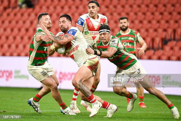 In this handout image provided by NRL Photos Gerard Beale of the Dragons is tackled during the round 20 NRL match between the St George Illawarra...