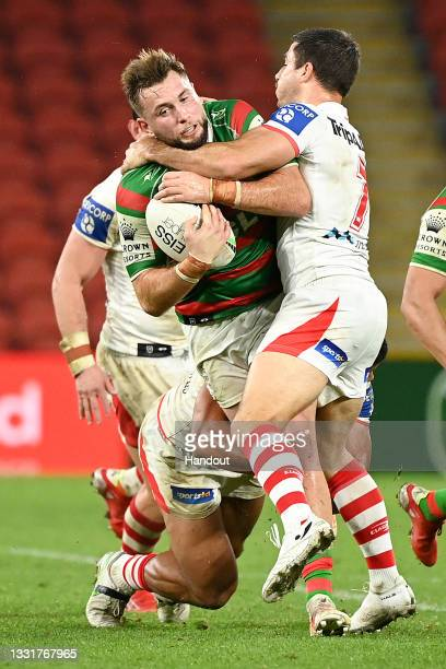 In this handout image provided by NRL Photos Jacob Host of the Rabbitohs is tackled during the round 20 NRL match between the St George Illawarra...