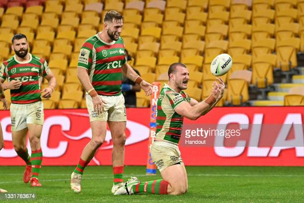 In this handout image provided by NRL Photos Jai Arrow of the Rabbitohs celebrates with team mates after scoring a try during the round 20 NRL match...