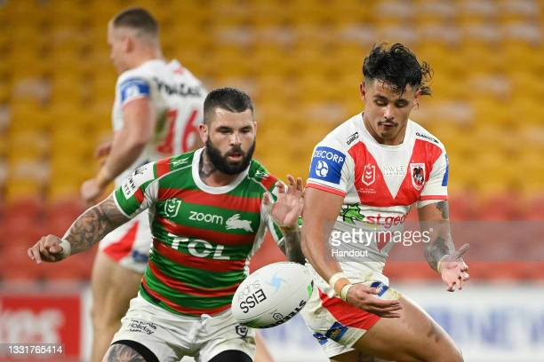 In this handout image provided by NRL Photos Jayden Sullivan of the Dragons in action against Adam Reynolds of the Rabbitohs during the round 20 NRL...