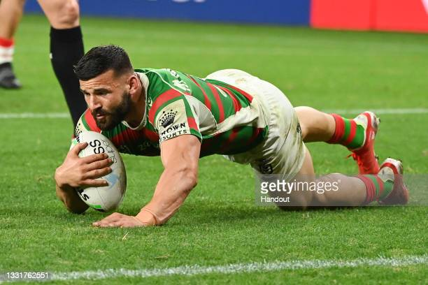 In this handout image provided by NRL Photos Josh Mansour of the Rabbitohs scores a try during the round 20 NRL match between the St George Illawarra...