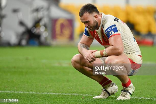 In this handout image provided by NRL Photos Kaide Ellis of the Dragons looks dejected after his team's defeat during the round 20 NRL match between...