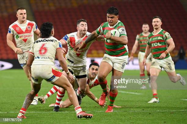 In this handout image provided by NRL Photos Latrell Mitchell of the Rabbitohs takes on the Dragons defence during the round 20 NRL match between the...
