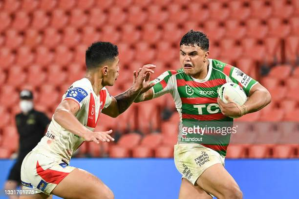 In this handout image provided by NRL Photos Mitchell Latrell of the Rabbitohs makes a break before scoring a try during the round 20 NRL match...