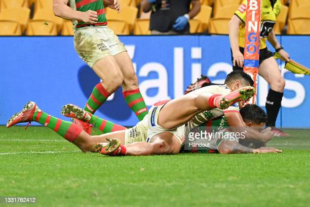 In this handout image provided by NRL Photos Mitchell Latrell of the Rabbitohs scores a try during the round 20 NRL match between the St George...