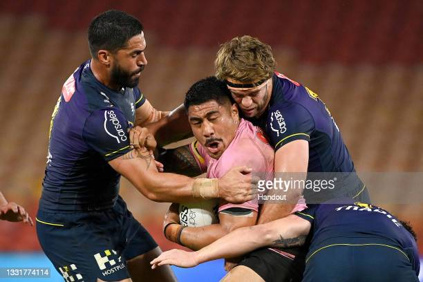 In this handout image provided by NRL Photos Moses Leota of the Panthers is tackled during the round 20 NRL match between the Melbourne Storm and the...
