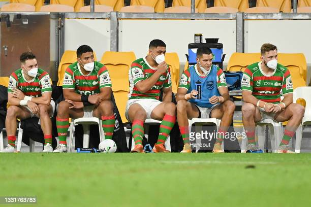 In this handout image provided by NRL Photos Rabbitohs players are seen in the bench area wearing masks during the round 20 NRL match between the St...