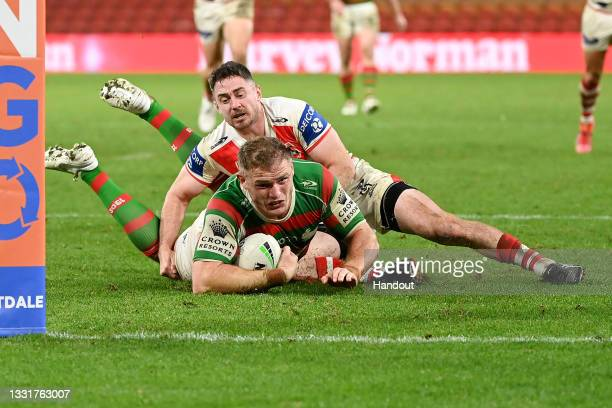 In this handout image provided by NRL Photos Thomas Burgess of the Rabbitohs scores a try during the round 20 NRL match between the St George...