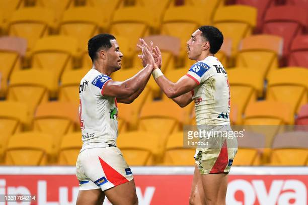 In this handout image provided by NRL Photos Tyrell Sloan of the Dragons celebrates with team mates after scoring a try during the round 20 NRL match...