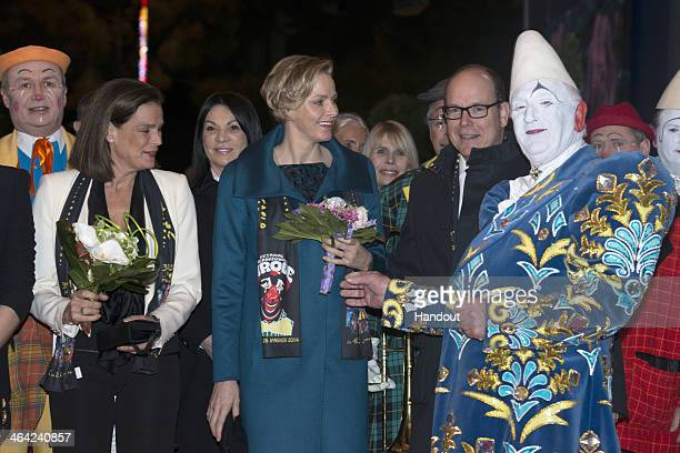 In this handout image provided by Palais Princier Princess Stephanie of Monaco Princess Charlene of Monaco and Prince Albert II of Monaco attend the...