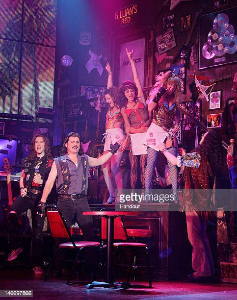 In this handout image provided by Paul Kolnik the cast of 'Rock Of Ages' perform in the fivetime Tony nominated musical at The Helen Hayes Theatre...