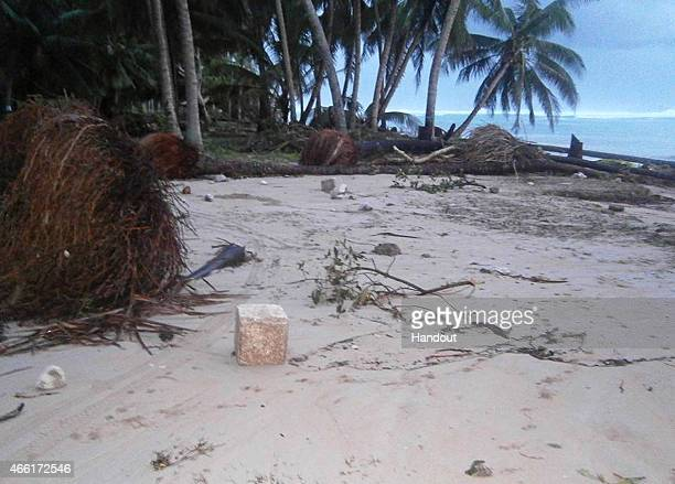 In this handout image provided by Plan International Australia a beach is littered with debris from the storm surge on March 14 2015 on the island of...