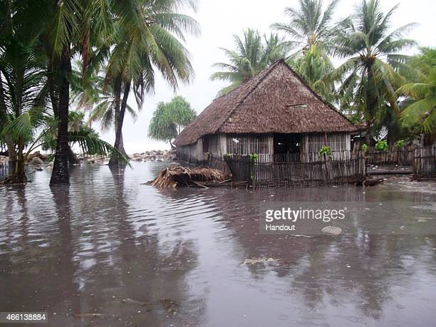 In this handout image provided by Plan International Australia flood waters surround a house March 13 2015 on the island of Kiribati Cyclone Pam is...