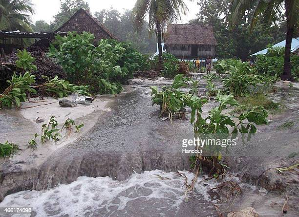 In this handout image provided by Plan International Australia flood waters move inland following a storm surge March 14 2015 on the island of...