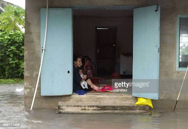 In this handout image provided by Plan International Australia Residents take shelter as flood waters move inland on March 14 2015 on the island of...