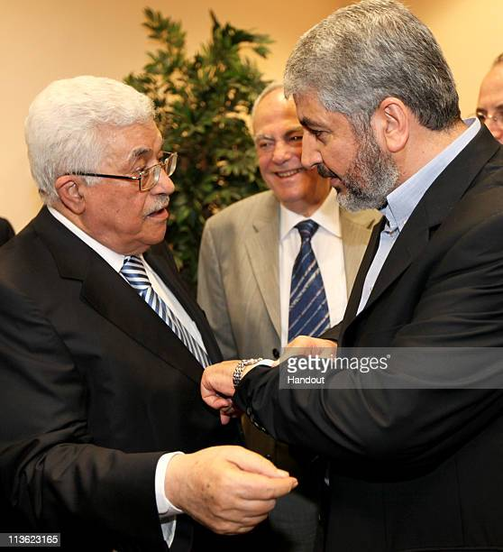 In this handout image provided by PPM Exiled Leader of Hamas Khaled Mashaal meets with President of the Palestinian National Authority Mahmoud Abbas...