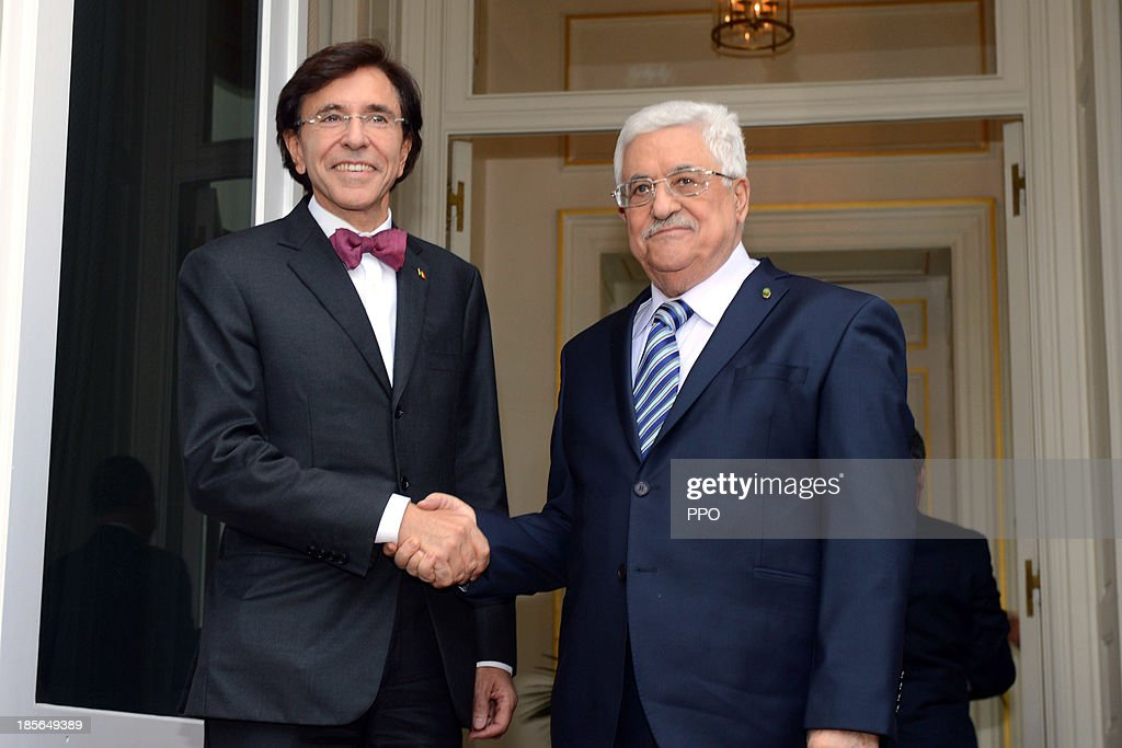 In this handout image provided by PPO, President Mahmoud Abbas (R) shakes hands with Belgian Prime Minister Elio Di Rupo October 23, 2013 in Brussels, Belgium. While in Brussels, Abbas urged foreign companies to boycott businesses based in Israeli settlements.