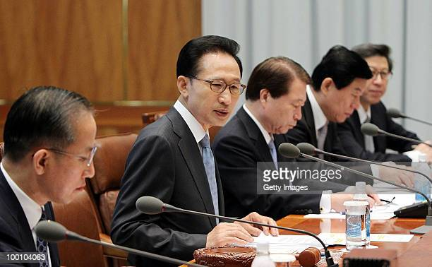 In this handout image provided by presidental house South Korean President Lee MyungBak speaks during the emergency national security meeting at...