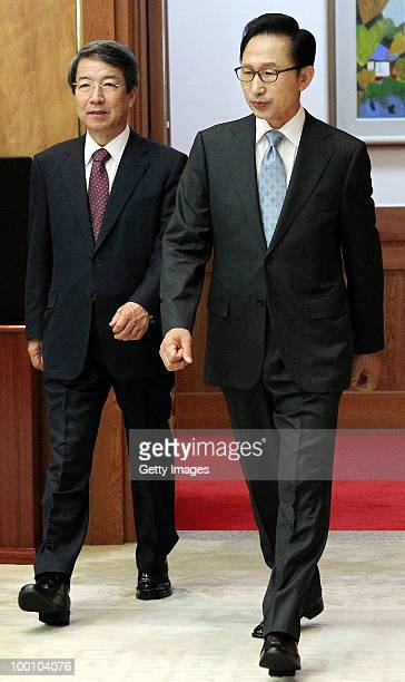 In this handout image provided by presidental house South Korean President Lee MyungBak and Prime Minister Chung UnChan arrive to attend the...