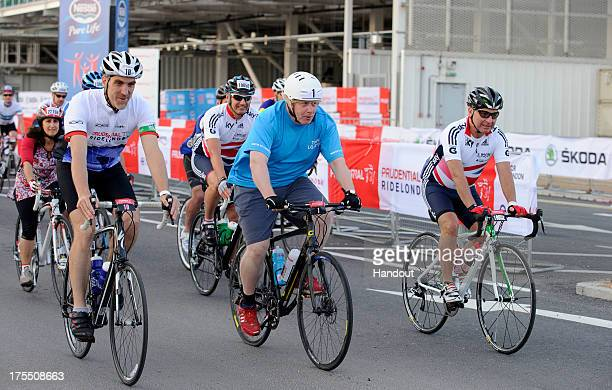 In this handout image provided by Prudential Ride London, Iain Edmondson and Mayor of London, Boris Johnson start the Prudential RideLondon-Surrey...
