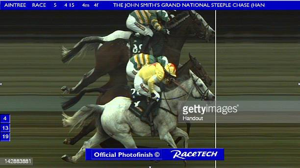 In this handout image provided by Racetech, the official photofinish shows grey horse Neptune Collonges, ridden by Daryl Jacob, edging a nose past...