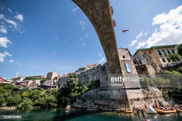 In this handout image provided by Red Bull Adriana Jimenez of Mexico dives from the 21 metre platform on Stari Most bridge during the final...