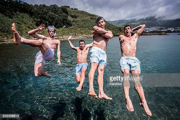 In this handout image provided by Red Bull American divers Andy Jones Kyle Mitrione Steven LoBue and David Colturi leap into the water at Islet...