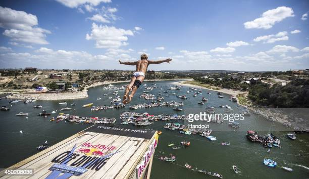 In this handout image provided by Red Bull Anatoliy Shabotenko of the Ukraine dives from the 28 metre platform at Hells Gate during the seeding round...