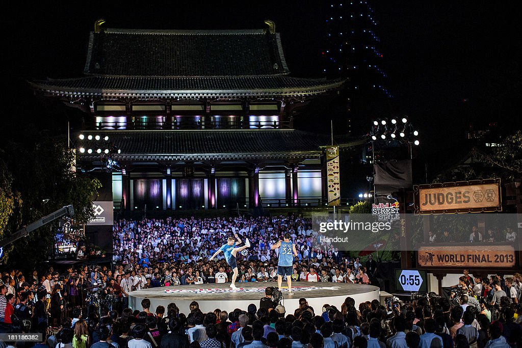 In this handout image provided by Red Bull, Andrew Henderson (L) of of the UK competes against Alexey Zhurakhovsky (R) of the Ukraine at Zojoji Temple during the Red Bull Street Style freestyle football world finals on September 19, 2013 at Tokyo, Japan.