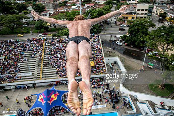 In this handout image provided by Red Bull Andy Jones of the United States dives from the 27 metre platform during the final rounds of the Red Bull...
